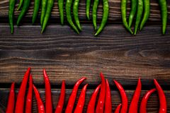 Fresh red and green chilli pepper pattern on wooden table background top view space for text. Food ingredients. Fresh red and green chilli pepper pattern on royalty free stock photo