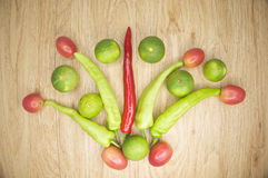Fresh red and green goat pepper lemon and tomato Stock Photo
