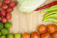 Fresh red and green goat pepper with tomato and lettuce Royalty Free Stock Photo