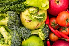 Fresh red and green vegetables top view. Top view group of green and group of red vegetables put together. Healthy diet concept, selective focus Stock Photos