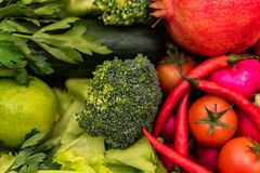 Fresh red and green vegetables top view. Top view group of green and group of red vegetables put together. Healthy diet concept, selective focus Royalty Free Stock Image