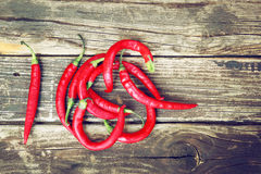 Fresh red hot chili peppers on an vintage wooden table Royalty Free Stock Photography