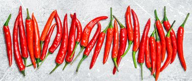 Fresh red hot pepper. On white rustic background royalty free stock photos