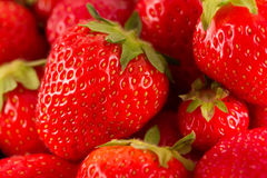 Fresh red juicy strawberries. A close-up of red ripe summer strawberries in a pile royalty free stock photos