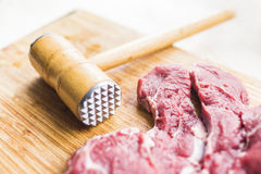 Free Fresh Red Meat And A Hammer For Beating Meat Royalty Free Stock Image - 91252636