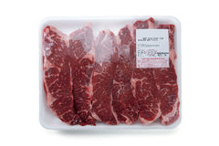 Fresh red meat packed in a poly bag. Stock Images