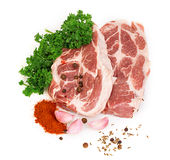 Fresh red meat with spices and parsley close-up on a white background. Royalty Free Stock Images