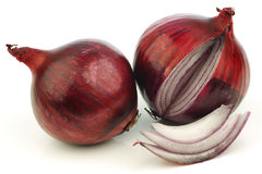 Fresh red onion and a cut one. On a white background Royalty Free Stock Image