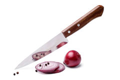 Fresh red onion with knife Royalty Free Stock Photo