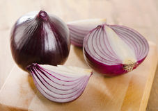 Fresh red onions on   wooden cutting board Stock Photography