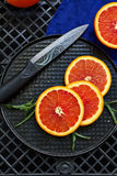 Fresh red oranges. On a black background Royalty Free Stock Photo