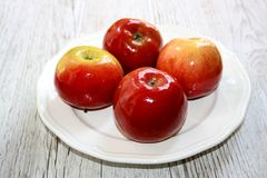 Fresh red apples. Fresh, red, organic apples from the farmers market on wooden table stock photography