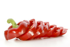 Fresh red paprika cut into slices. One fresh red paprika cut into slices Royalty Free Stock Images