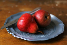 Fresh red pears on a plate Royalty Free Stock Image