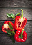 Fresh red pepper on wooden background royalty free stock photo