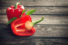 Fresh red pepper on wooden background royalty free stock photography