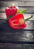 Fresh red pepper on wooden background stock images