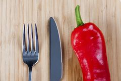 Red pepper on chopping board Royalty Free Stock Photography
