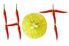 Fresh red peppers. Fresh red peppers and sliced lemon isolated on white background Royalty Free Stock Photo