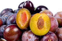 Fresh red plums with one sliced open Stock Image