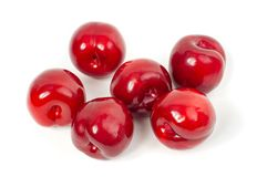 Fresh red plums on white background. Dieting royalty free stock image