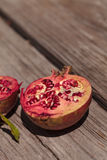 Fresh red pomegranate fruit. Punica granatum in summer Stock Photography
