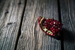 Fresh red pomegranate and grapefruit On a wooden background. Pomegranate Royalty Free Stock Photo