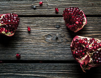 Fresh red pomegranate and grapefruit On a wooden background. Pomegranate in plate on wood background. Stock Photo