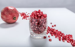 Fresh red pomegranate seeds. Sprinkled in a glass Royalty Free Stock Photos