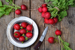Fresh red radish for salad on wooden background. Healty food. Royalty Free Stock Images