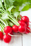 Fresh red radish on white boards. Food Royalty Free Stock Photos