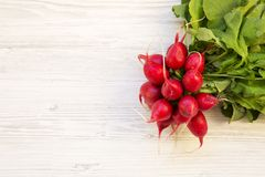 Fresh red radish on white wooden table, top view. Copy space Stock Photo