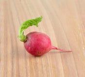 Fresh red radish  on wooden  background. Fresh red radish  on a  wooden  background Stock Image