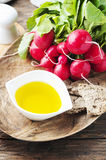 Fresh red radish on the wooden table. Selective focus Royalty Free Stock Photo