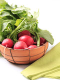 Fresh red radishes. In a terracota bowl Stock Photography