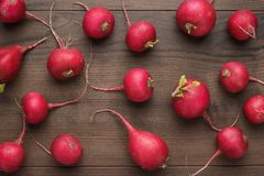 Fresh red radishes. On the wooden table Stock Photography