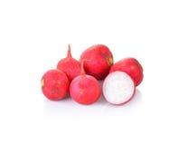 Fresh red radishes on white background. Fresh red radishes on a white background Royalty Free Stock Image