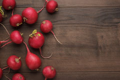 Fresh red radishes. On the wooden table Stock Photo