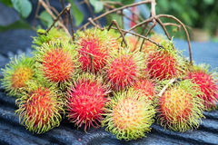 Fresh red rambutan sweet delicious fruit. Plum-sized tropical fruit with soft spines and a slightly acidic taste, cultivated in ma Stock Photography