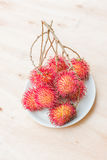 Fresh red rambutan Stock Photos