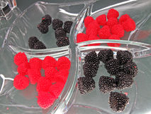 Fresh red raspberries, black blackberries, glass, Royalty Free Stock Photography