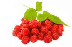 Fresh red raspberries with leaves. Isolated on white background Stock Photos