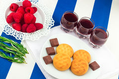 Fresh Red Raspberries on a white artistic plate stock image