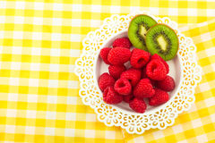Fresh Red Raspberries on a white artistic plate royalty free stock images