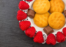 Fresh Red Raspberries on a white artistic plate stock photography