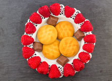 Fresh Red Raspberries on a white artistic plate royalty free stock photo