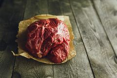 Raw meat on a wooden background. Fresh red Raw meat on a wooden background Royalty Free Stock Image