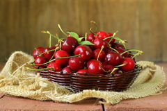 Fresh red ripe cherries in wicker basket Royalty Free Stock Photography