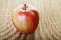 Gala Apple on Bamboo Mat Stock Photos