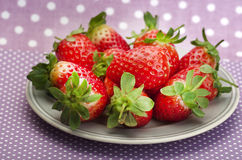 Fresh red ripe strawberries on dotty background Royalty Free Stock Photography